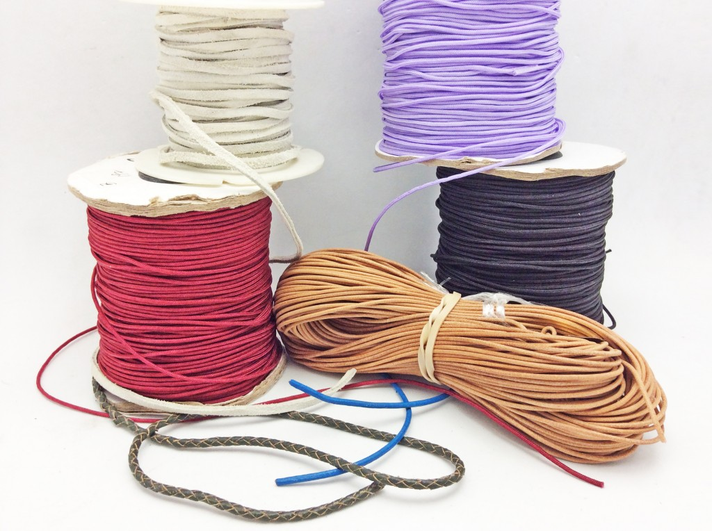 A few different kinds of thick leather and nylon cord.