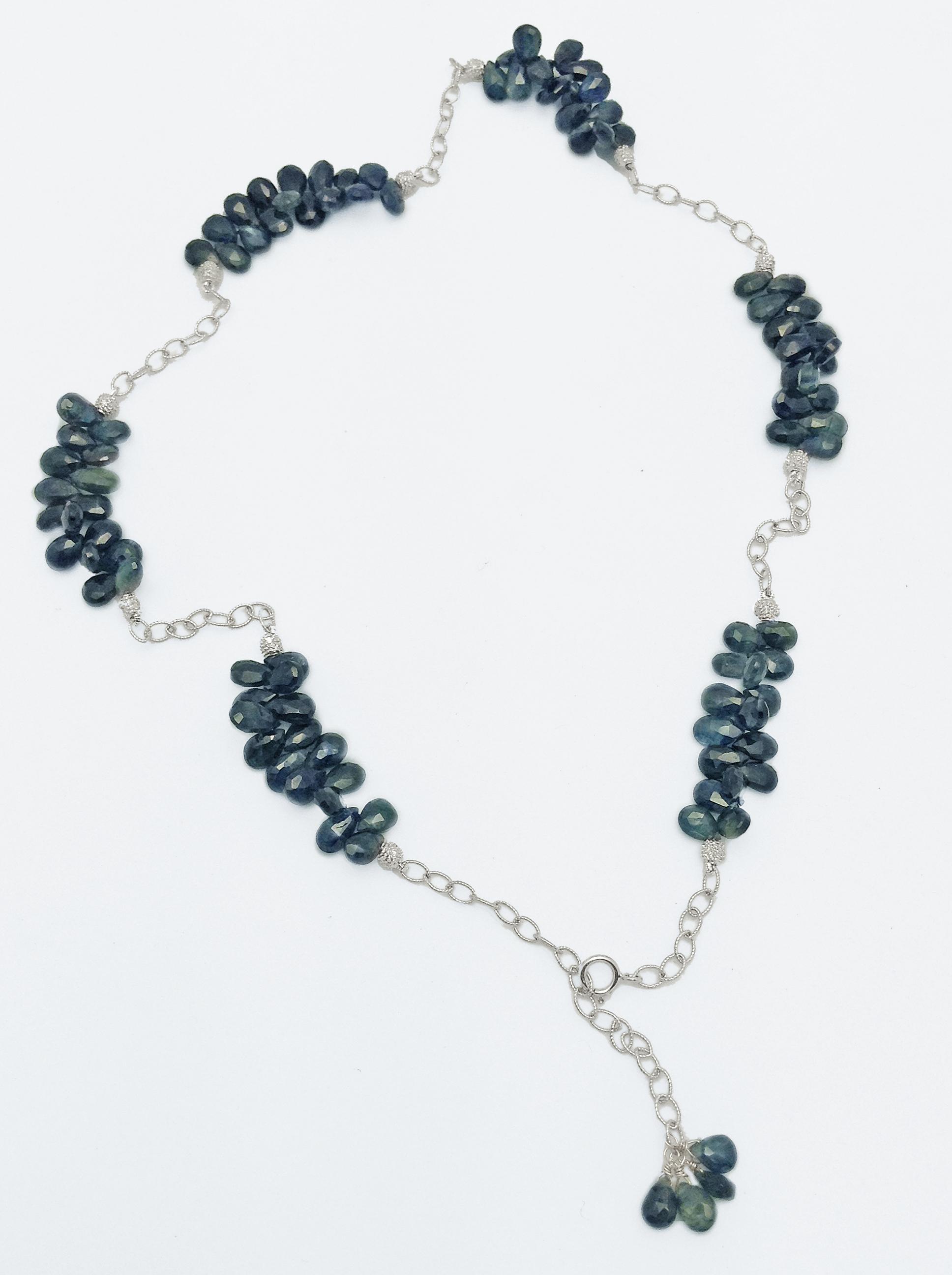 Pear Shaped Blue Sapphire Segments with Diamond Segments