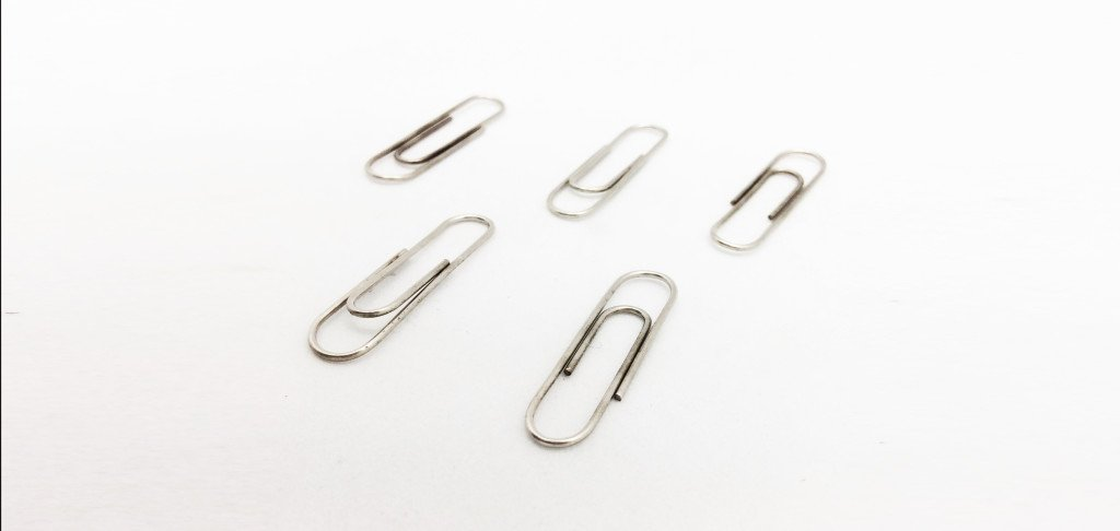 The Stainless Steel in Paper Clips acts as a catalyst and will help the Oxidation reaction go--especially with difficult Silver pieces.