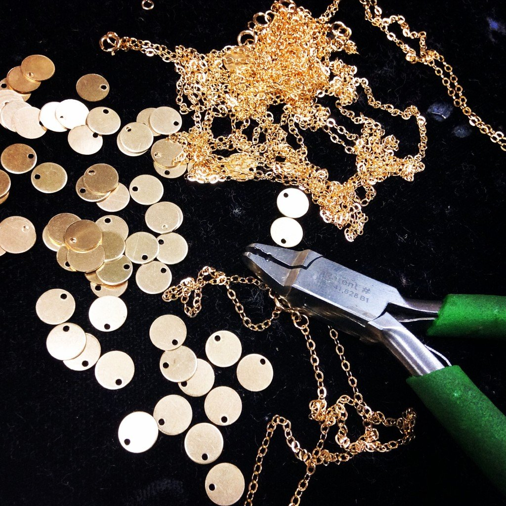 Gold Filled chains, blank tags, and a flat nose plier.